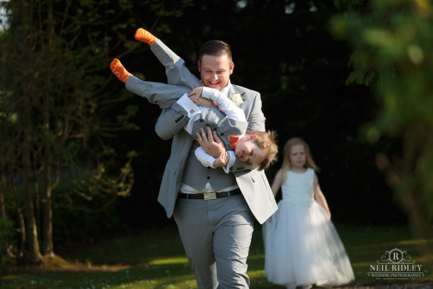 Young family enjoy the grounds at The Great Hall at Mains