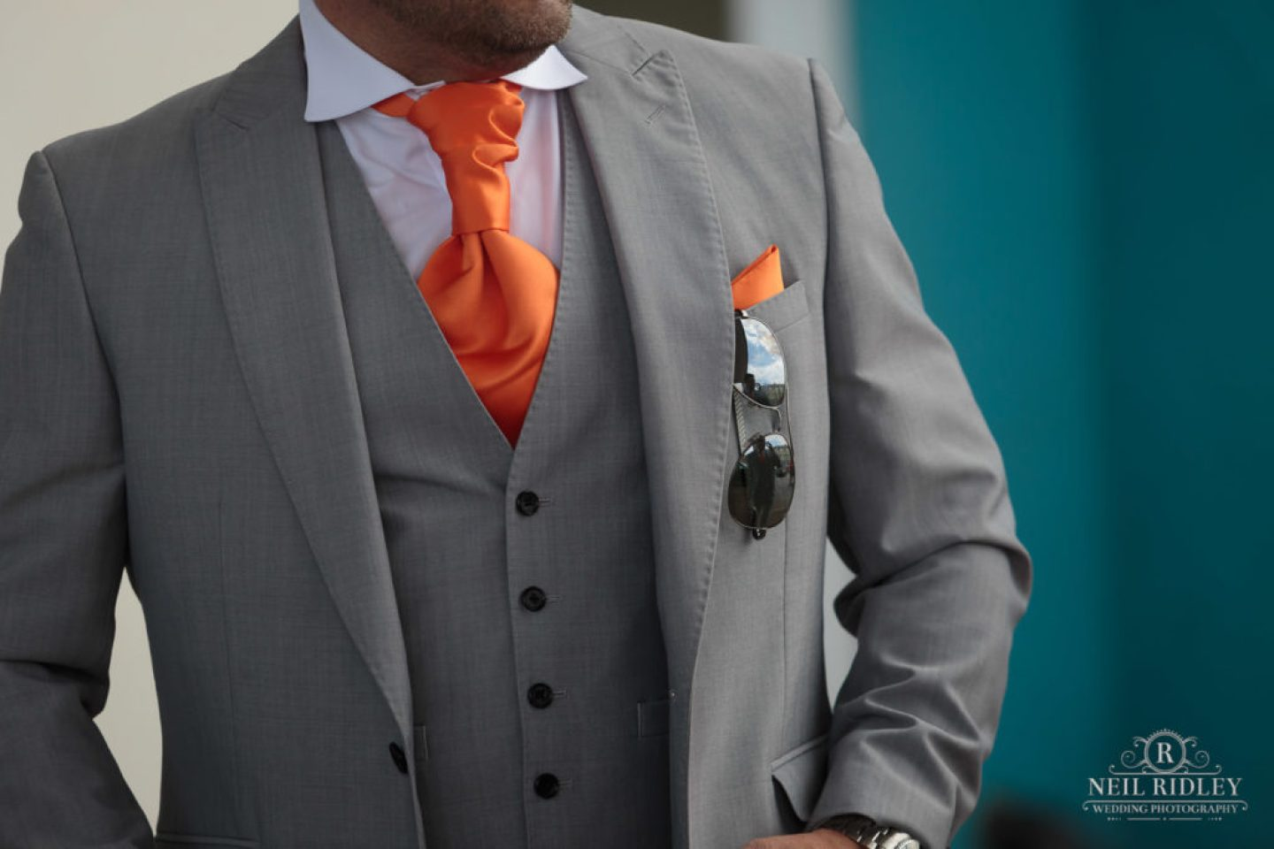 Grooms Grey suit outside The Big Blue Hotel in Blackpool