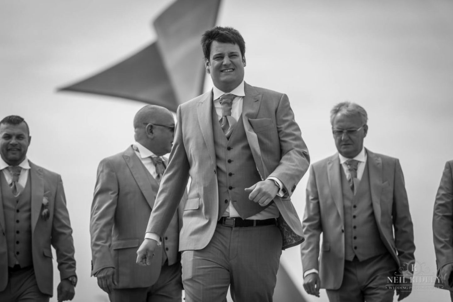 Black and white image of Groom and his party on promenade in Blackpool
