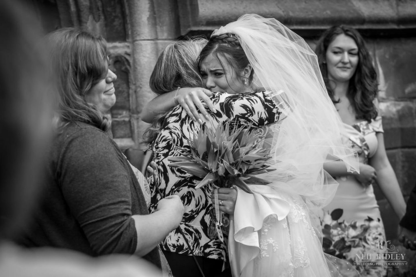 Bride hugs relative outside St Thomas Church in St Annes-on-Sea