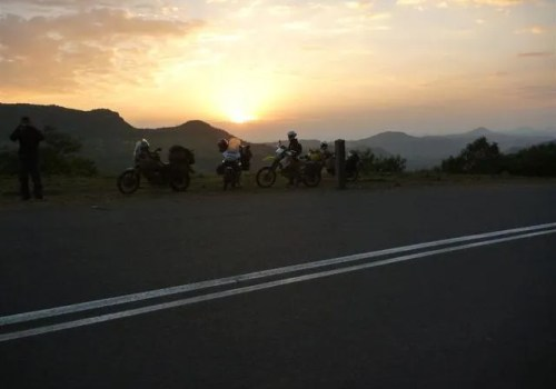 Roadside photograph of motorbikes looking over Ethiopian mountains