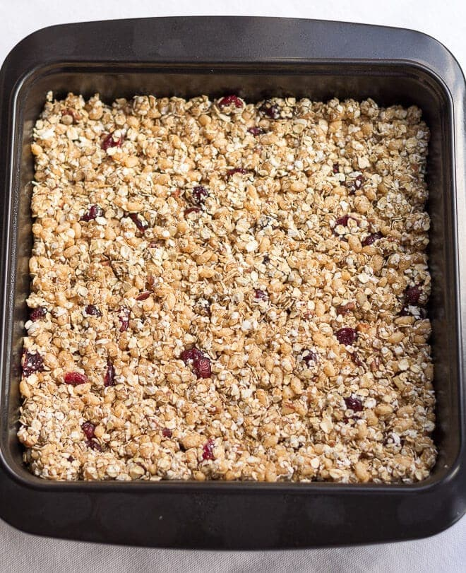 No bake cranberry flapjacks are delicious, chewy and just packed full with all the goodness of porridge oats, pecan nuts, almond butter and cranberries. They're great as little treats with the minimum of effort required too!