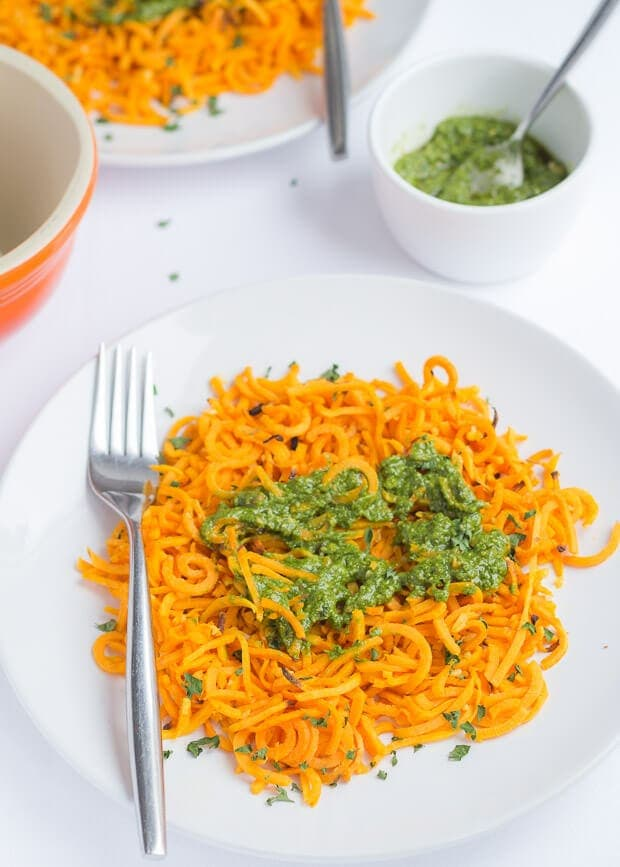 Baked spiralized sweet potato with spinach pesto takes hardly any time at all to make. Packed full of healthy nutrients and made with just a few simple ingredients, this tasty vegetarian quick healthy meal recipe will satisfy those sweet potato cravings!