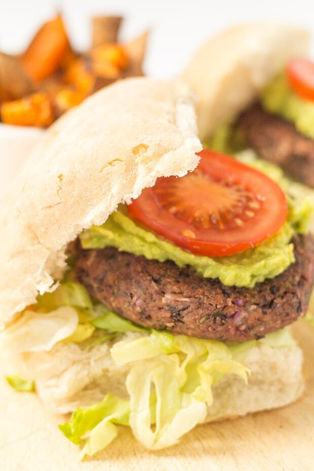Quick and easy black bean burgers are perfect for cooking in a pan or on your BBQ. No matter what the weather or if you're short on time, these delicious budget vegan burgers are the business!