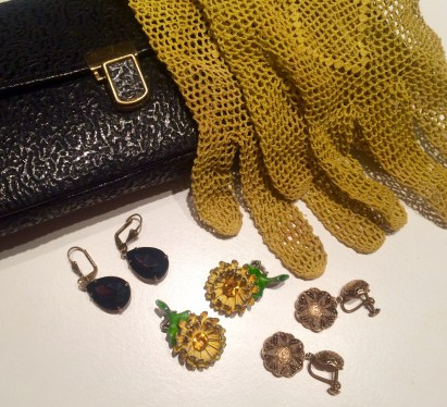 The sunflower earrings (my favorites), drop shaped earrings in dark purple, and those third ones were actually a birthday present; a pair of lace gloves and the clutch I had on my wedding day.