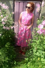 A pink flower dress with a 90s vibe was a find at the flea market section. The sunglasses are from Ansa.