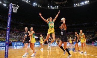 Netball player jumping to block
