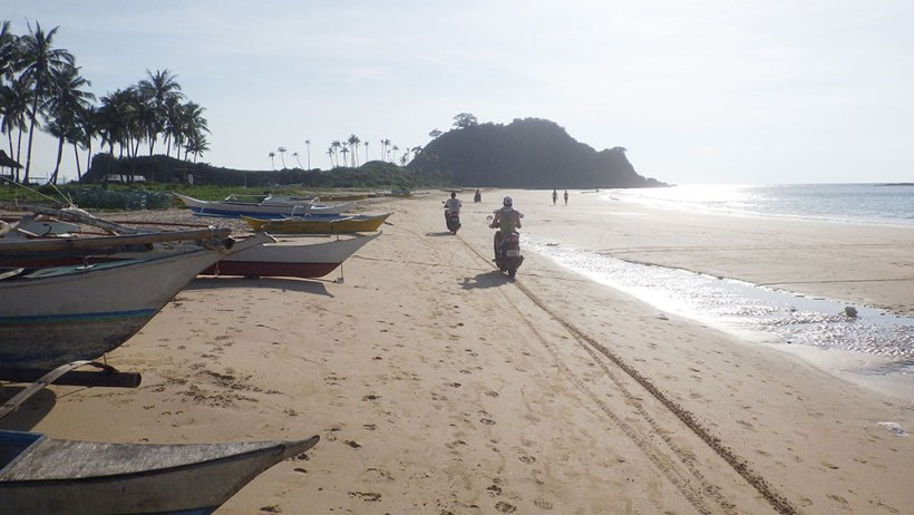 Riding a scooter on Nacpan Beach