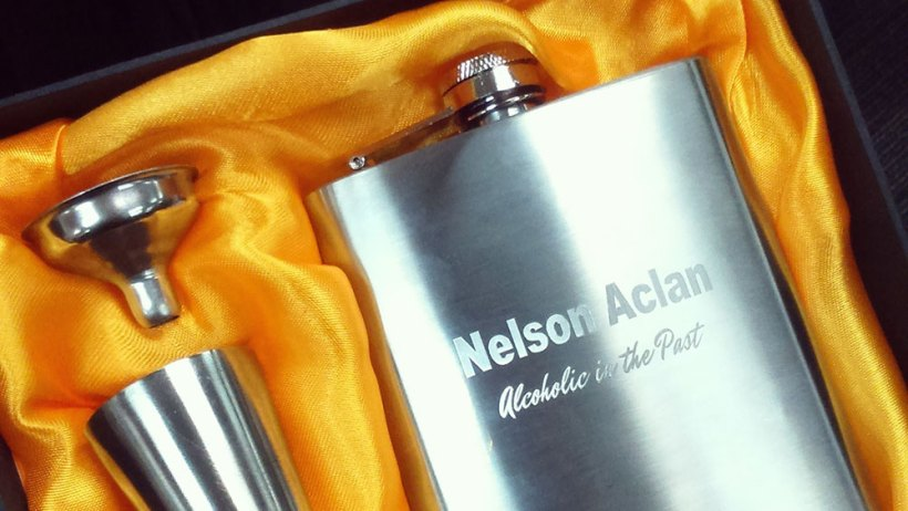 Travel packing checklist top priority: a hip flask