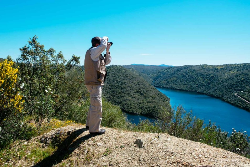 A visitor shoots a picture from a high vantage point in the Tejo Internacional Nature Park, Malpica do Tejo, 2016
