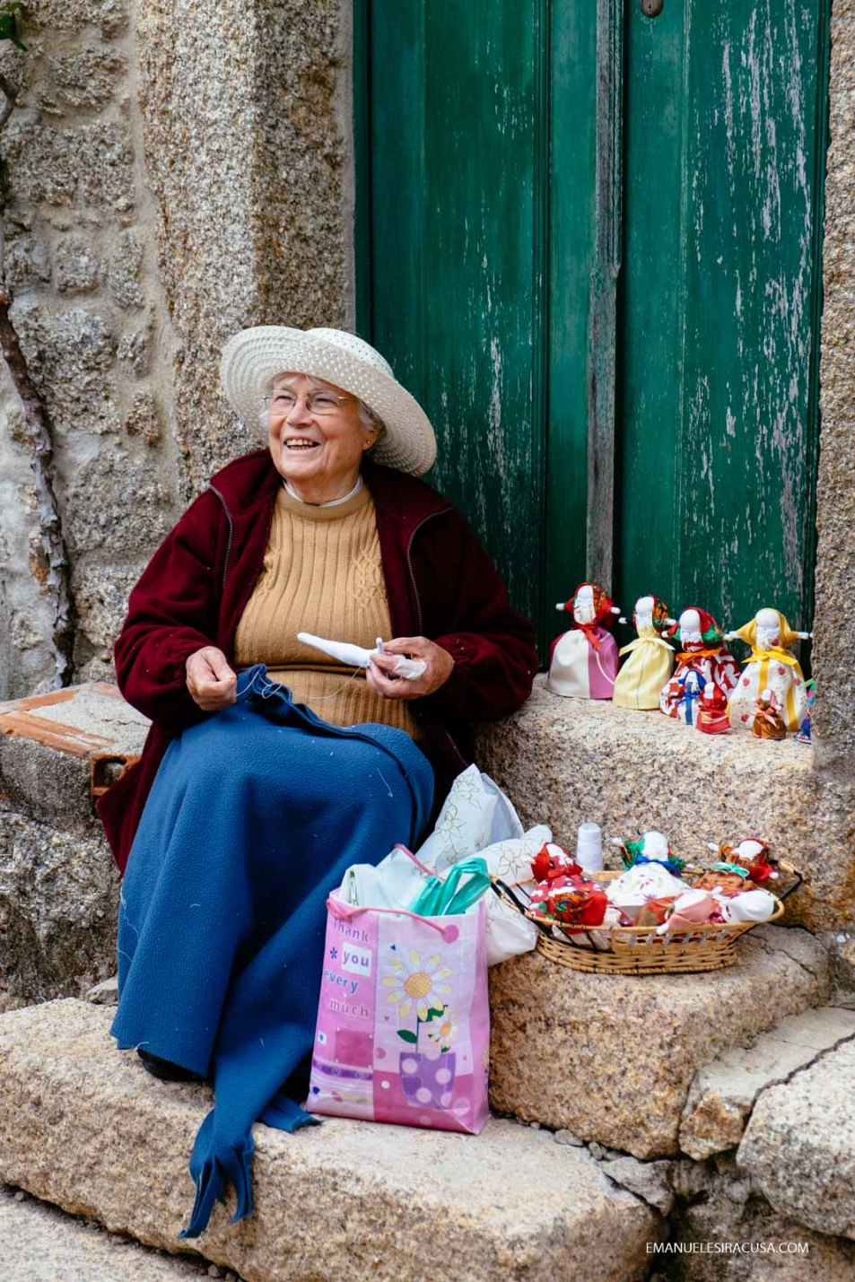 A local elderly lady selling dolls and other hand-made products in the streets of Monsanto, 2016