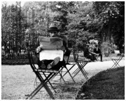 | Jardin de Luxembourg (man reading newspaper with feet on chair), 1928 |