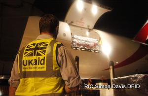 s300_UK_aid_worker_Alex_Franklin_supervises_unloading_of_humanitarian_supplies_Credit_Simon_Davis_DFID
