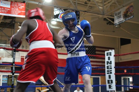 First Flight wrestler Jeremiah Derby (right) fought three rounds against Khalil Olverson in an amateur bout, Saturday, April 23, 2016 at PAL Gym in Elizabeth City.