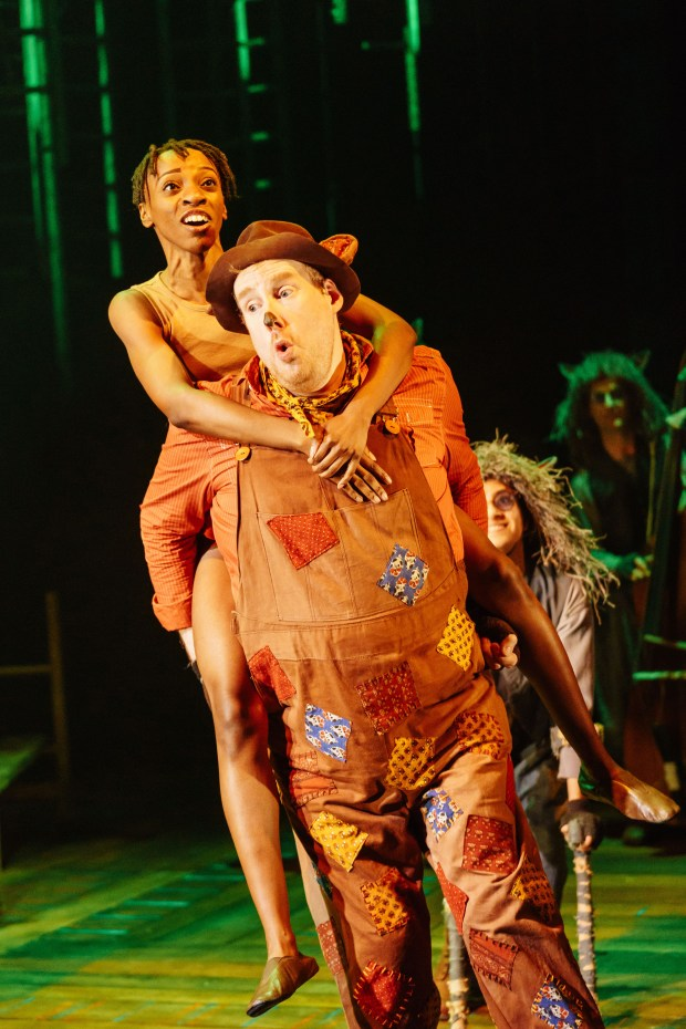 3 THE JUNGLE BOOK - Kezia Joseph as Mowgli and Dyfrig Morris as Baloo - photo by Manuel Harlan