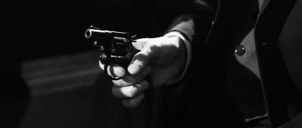 photo of person holding a handgun