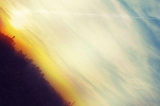 【高解像度】夕暮れの街並みと飛行機雲(3パターン)