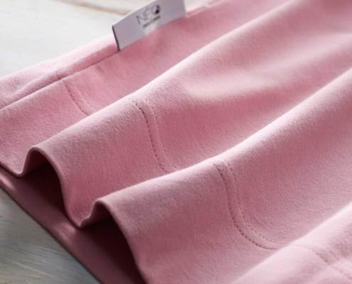 NEO powder pink kangaroo and skin to skin wrap detail recommended by childcare units for full term or premature babies