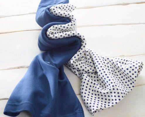 The floral blue Neo kangaroo wrap is recommended by childcare units for full term or premature babies