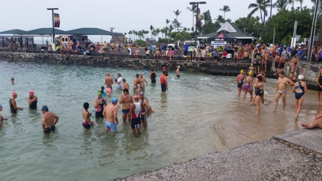 Athletes doing a practice swim at the starting point of IRONMAN World Championships in Kona,.