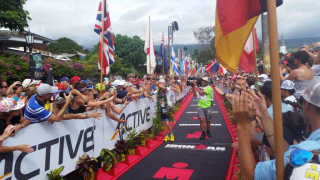 Patrick Lange celebrates with the crowd at the 2016 IRONMAN World Championships after coming in 3rd.