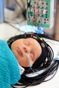 Infant asleep while having an optical-EEG scan