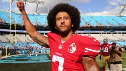 Charlotte, NC - September 18, 2016: San Francisco 49ers quarterback Colin Kaepernick (7) walks off the field at Bank of America Stadium with his fist up in the air after their game against the Panthers.(Gerry Melendez for ESPN)