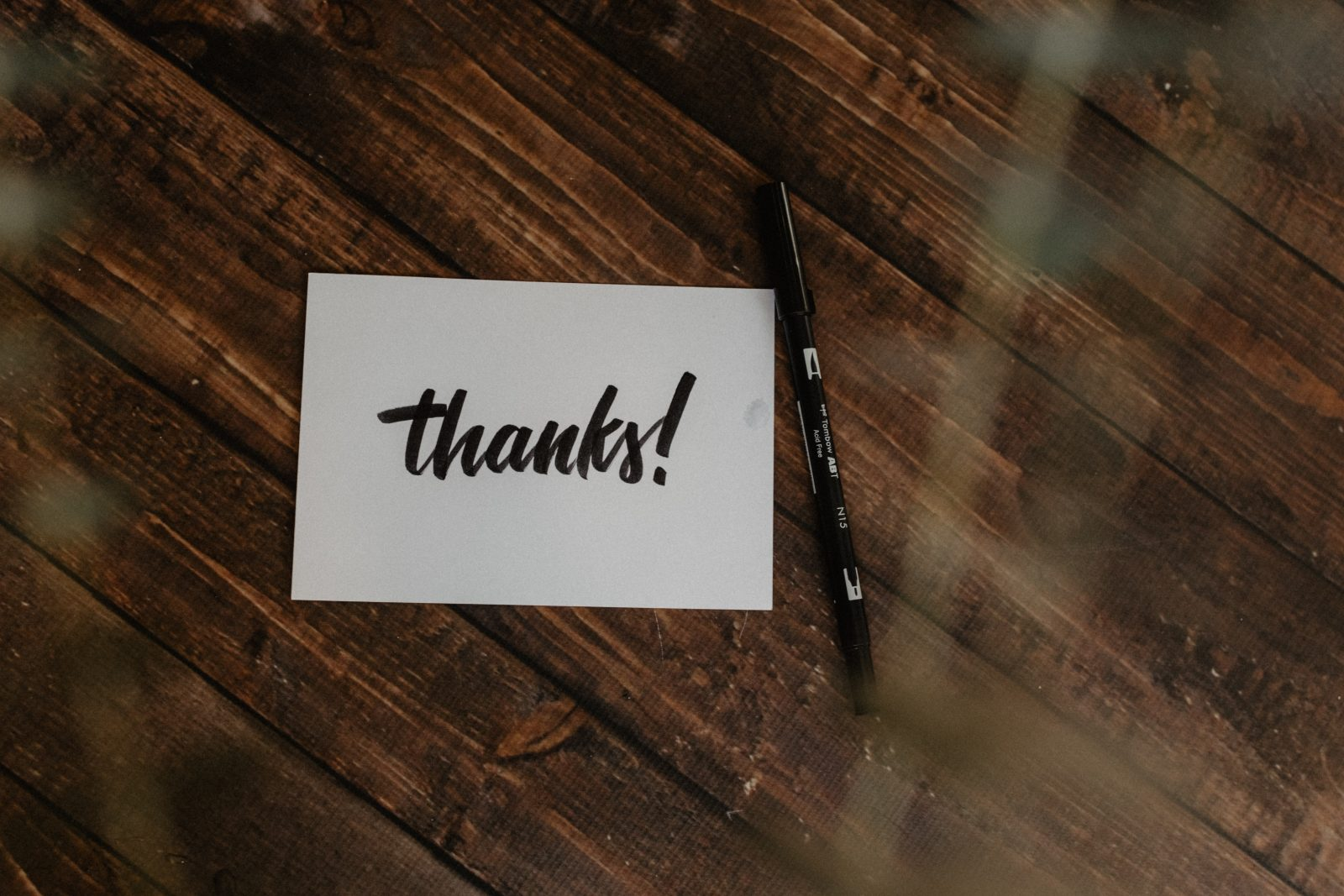 A thank you card for volunteer appreciation week on a wooden table