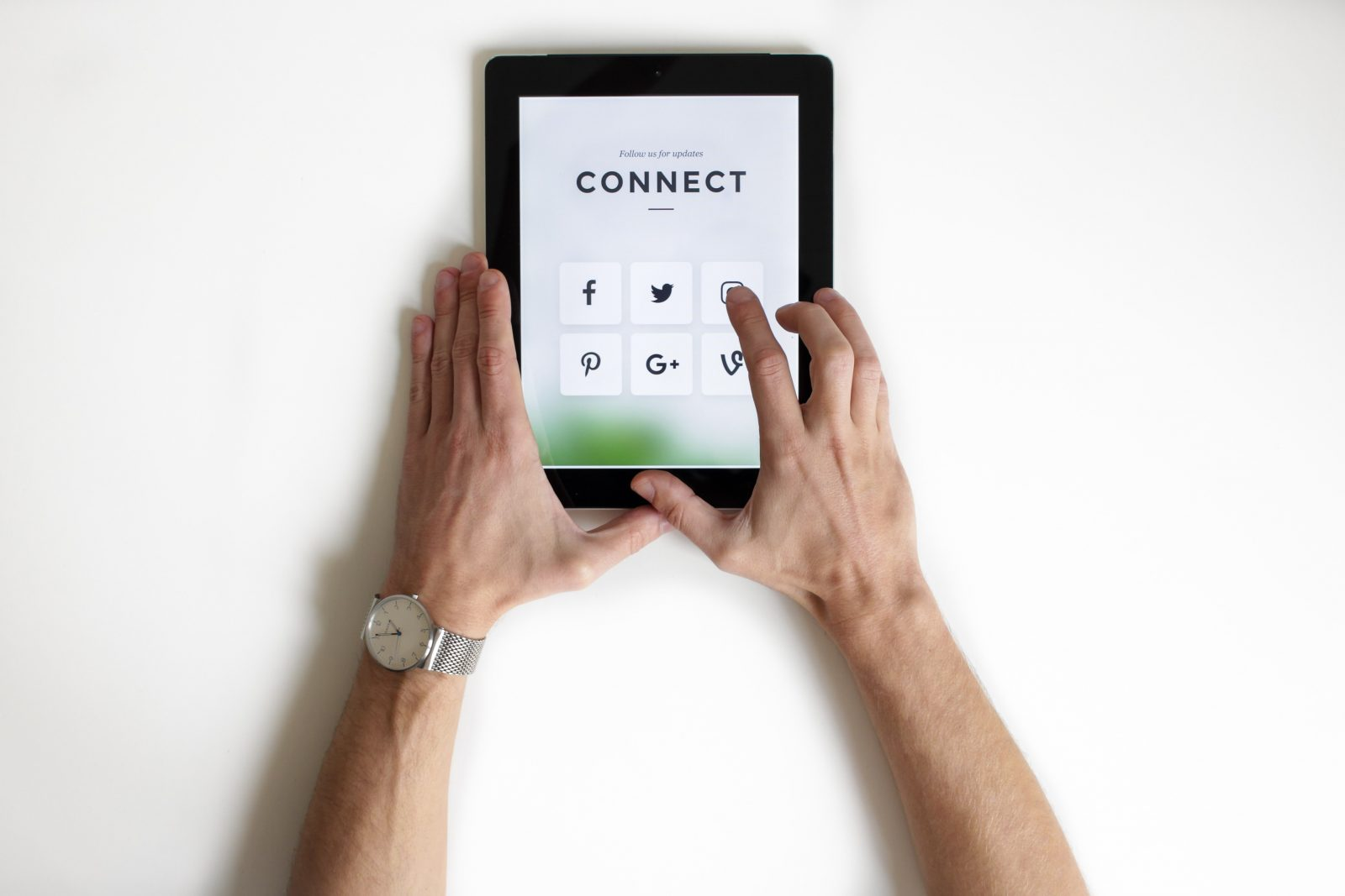 """iPad that has social media graphics and the word, """"connect."""""""