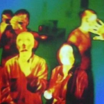 Infrared photo of people showing their contrasting temperatures (red, yellow) with their surroundings (blue).