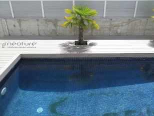 Tarima piscina madera sintética exterior.