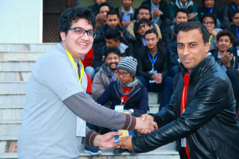 Sakar (left) accepting his token of love