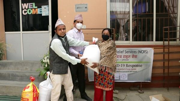 Ward office representatives distributing food items