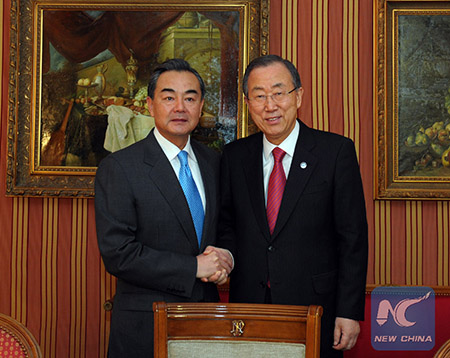 (140123) -- MONTREUX, Jan. 23, 2014 (Xinhua) -- Chinese Foreign Minister Wang Yi (L) meets with United Nations Secretary-General Ban Ki-moon in Montreux, Switzerland, Jan. 23, 2014. (Xinhua/Qian Yi) (djj)