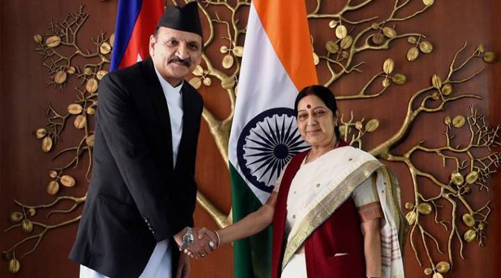 New Delhi: New Delhi: External Affairs Minister Sushma Swaraj  shakes hands with Nepal Foreign Affairs Minister Prakash Sharan Mahat at a meeting in New Delhi on Monday. PTI Photo by Subhav Shukla(PTI9_12_2016_000042A)