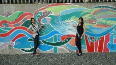 Nagma Shrestha proudly showcasing mural painting