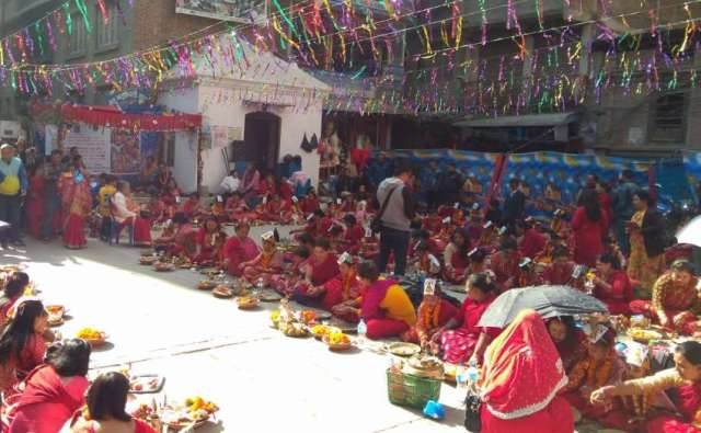 """Newari girls participate in mass """"ihi"""" or """"bael bibaha"""" ceremony at Woto Tole. It is a ceremony in the Newar community in Nepal in which pre-adolescent girls are """"married"""" to the bael fruit (wood apple), which is a symbol of the god Vishnu, ensuring that the girl becomes and remains fertile."""