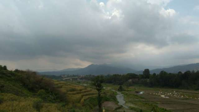 Potato field and mountains as seen from  Changunarayan – Sankhu road.
