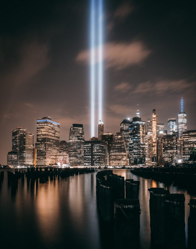 The 9/11 memorial: Two beams of light shining up into an evening sky in lower Manhattan.