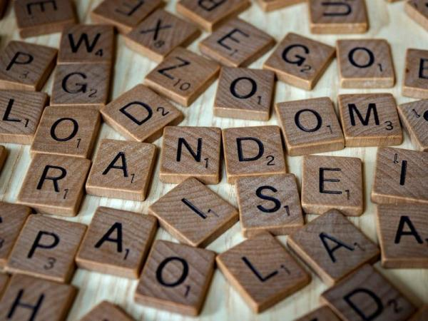 The image shows a pile of scrabble letters.