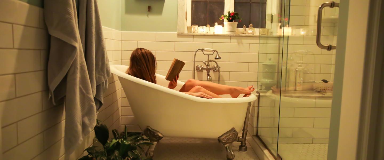 Woman in a bathtub reading