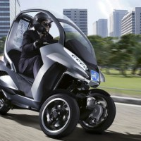 Peugeot high tech three wheel hybrid is a cross between scooter and car