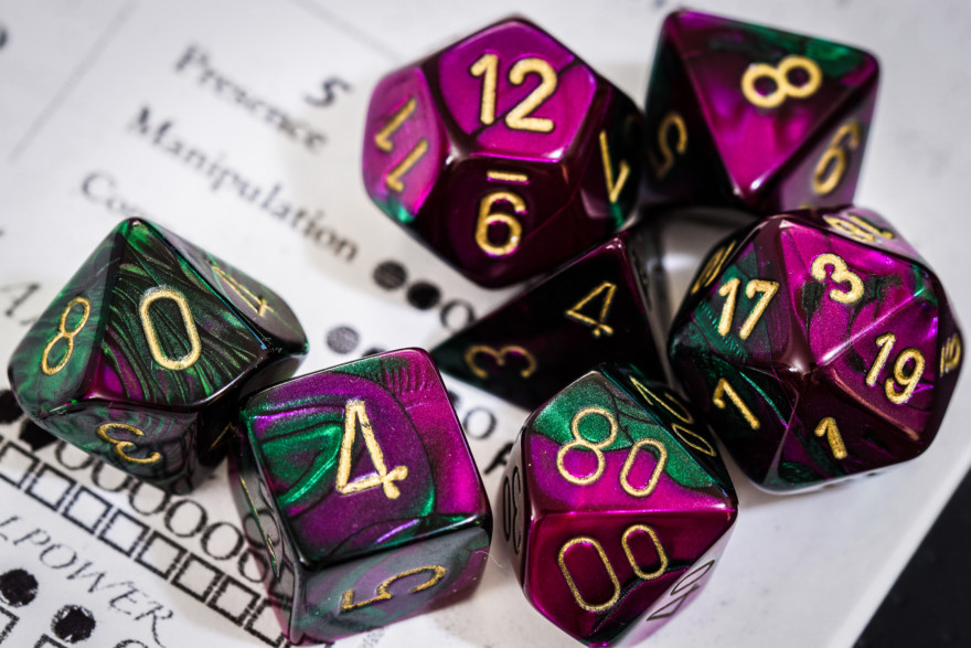 Green And Purple Polyhedral Dice