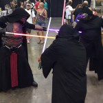 fans in Star Wars costume as Kylo Ren, Darth Revan, and anonymous Jedi