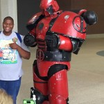 Cosplayer dressed as a Deadpool version of the Warhammer 40K space marine