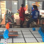 Vex challenge involving human controlled robots and molecule shapes.