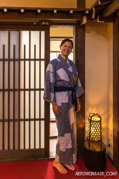 Me in yukata posing in front of our room door