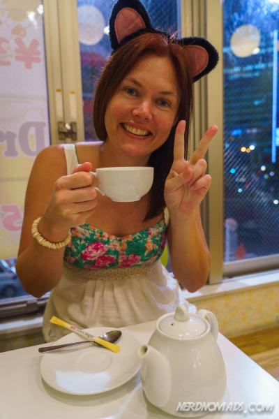 Me having a cup of tea with crazy Maid Cafe ears! :)