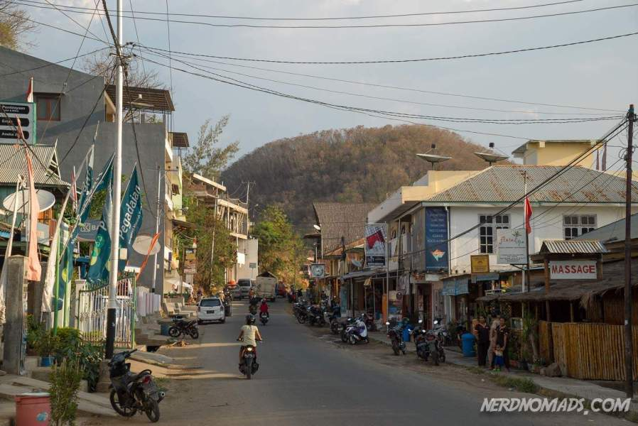 The main street of Labuan Bajo, packed with tour operators for Komodo National Park.
