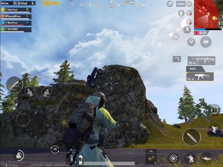 PUBG Mobile screenshot showing Monster Truck stuck on rocky outcrop